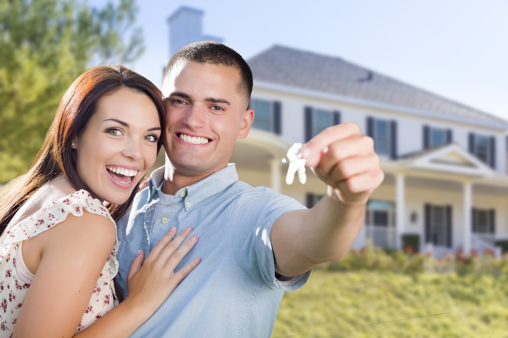 Military Couple In Front of New Home